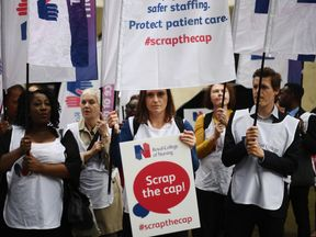Theresa May is under pressure to lift the 1% cap on public sector pay increases