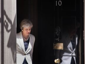Theresa May waits to welcome Estonian Prime Minister Juri Ratas to Downing Street