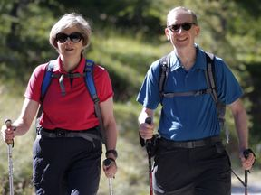 Theresa May with her husband Philip at the start of a summer holiday in the Alps in 2016