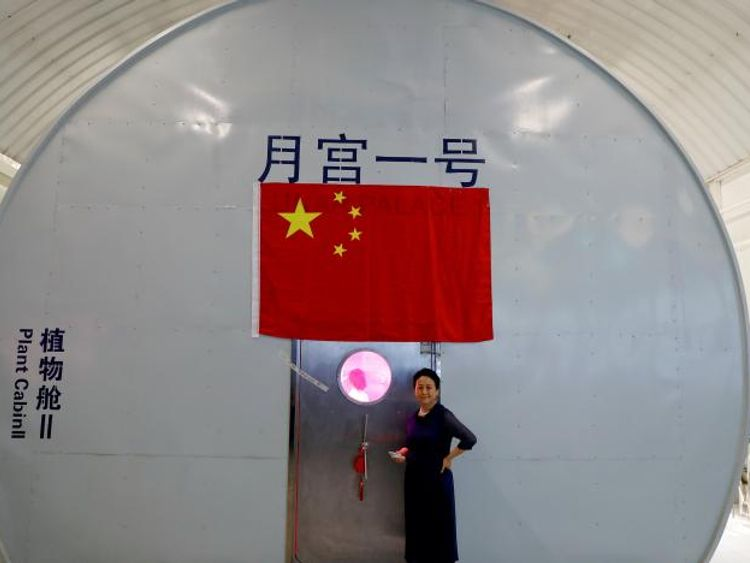 Liu Hong, chief designer of the Lunar Palace 365 Project stands outside a simulated space cabin. Pic: REUTERS/Damir Sagolj