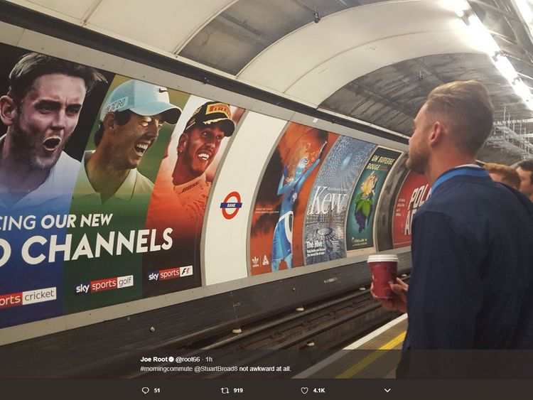 Stuart Broad stares at a poster of himself