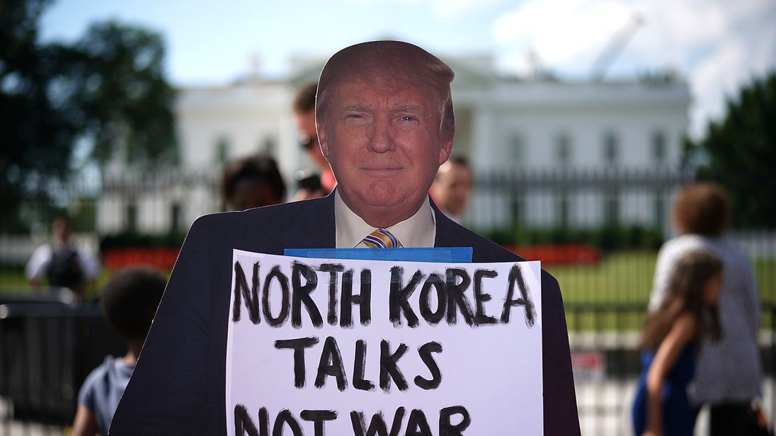 A cardboard cutout of Donald Trump outside the White House during a North Korea protest