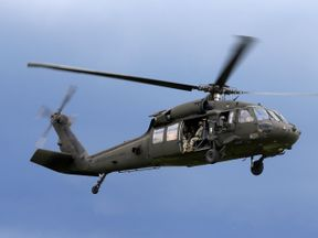The UH-60 Black Hawk helicopter is a four-bladed twin engine utility helicopter, manufactured for the army (file pic)