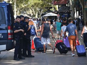 Armed police stand guard on Las Ramblas boulevard