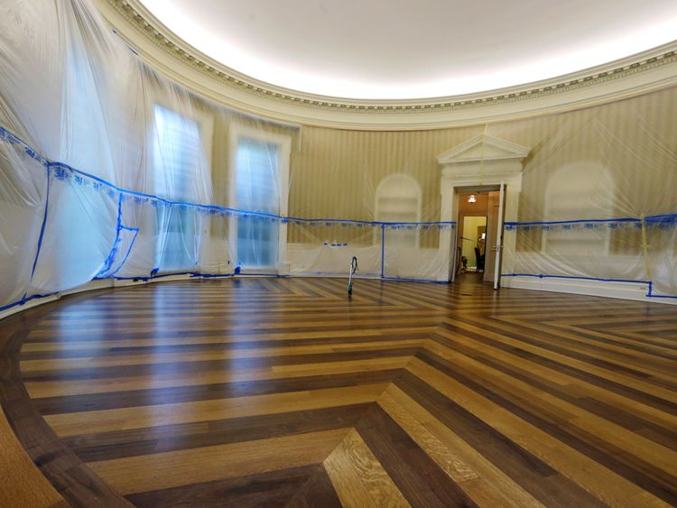 WASHINGTON, DC - AUGUST 11: The Oval Office sits empty and the walls covered with plastic sheeting during renovation work at the White House August 11, 2017 in Washington, DC.