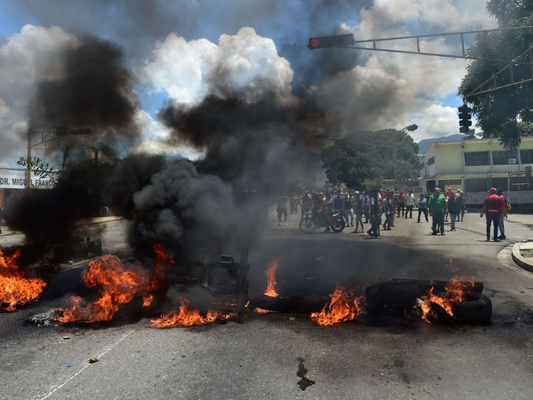 Protesters set a barricade on fire in Valencia, Venezuela's third-biggest city