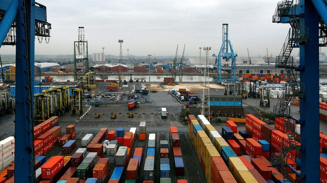 Ship freight containers sit on Tilbury Dock on February 1, 2007