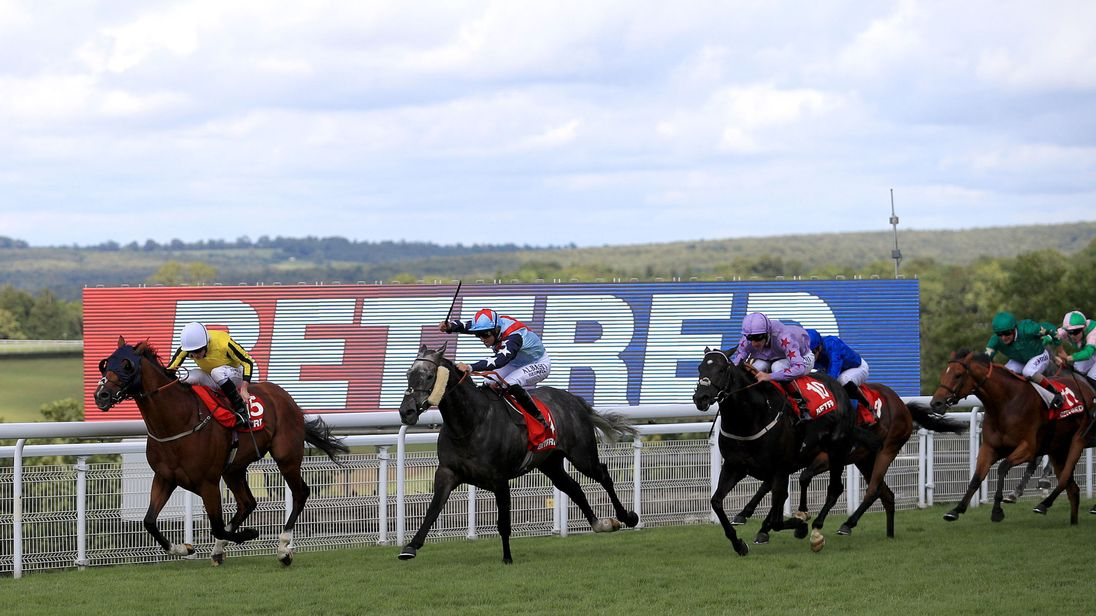 Franklin D (left) and Ryan Moore land a huge gamble in the Betfred Mile