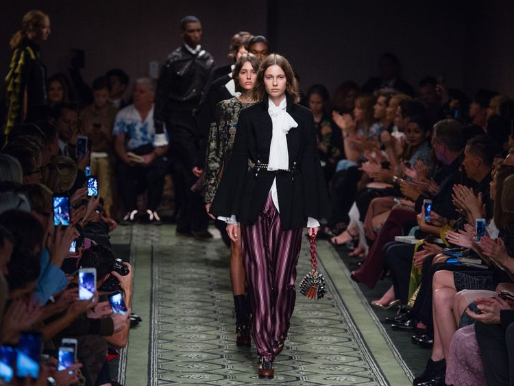 Models walk the runway at the Burberry show