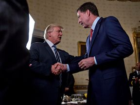 President Donald Trump shakes hands with James Comey