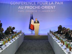 French President Francois Hollande addresses the conference