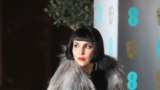 Actress Noomi Rapace was one of the few stars dressed for the cold