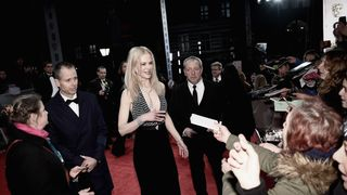 Better after: Kidman barely shivering as she signed autographs later