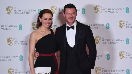 Daisy Ridley (L) and British actor and singer Luke Evans (R)