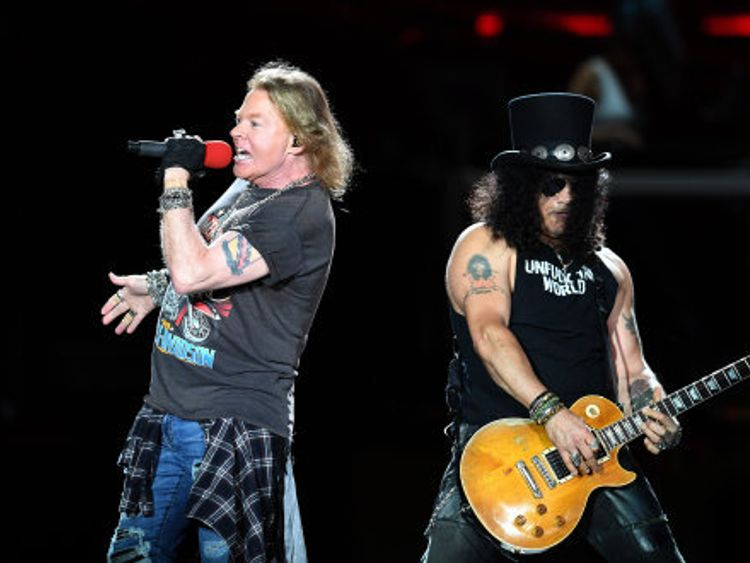 Axl Rose and Slash perform together earlier in the tour in Brisbane