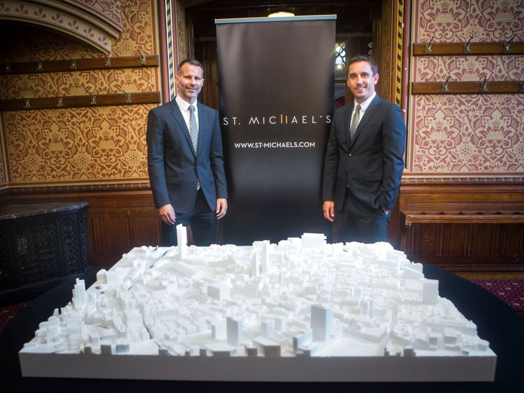 Ryan Giggs and Gary Neville with a model of their St Michael's development