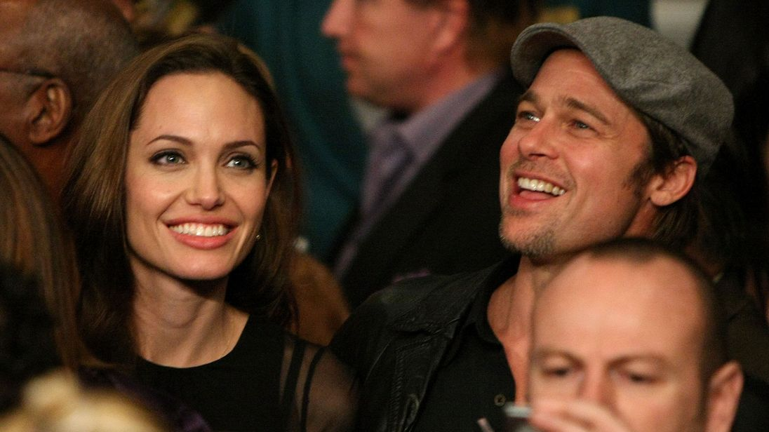 LAS VEGAS - DECEMBER 08:  Actors Angelina Jolie and Brad Pitt talk before the fight between Ricky Hatton of England and Floyd Mayweather Jr. prior to their