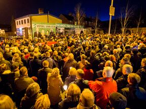 Mourners attend a vigil for Martin McGuinness in west Belfast