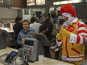 Ronald McDonald behind the counter in the fast food restaurant