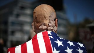 Mike Stutz is seen with his head covered in plasters to protest against President Trump's proposed replacement for Obamacare in Los Angeles