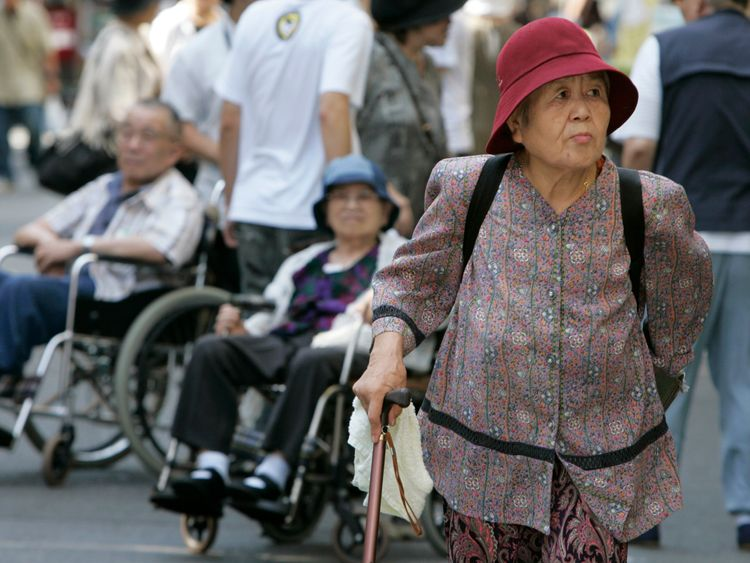 A woman strolls through Tokyo's Sugamo district, an area popular among the Japanese elderly, September 20, 2007