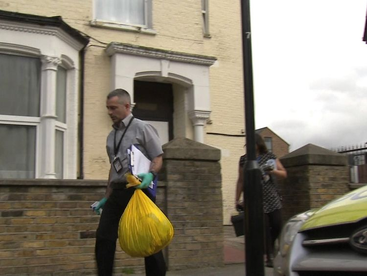 Police at the house on Wilberforce Road, where one-year-old twins were found with serious injuries