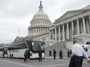 US Senators board buses at the US Capitol in Washington, DC, April 26, 2017, as they prepare to drive to the White House for a briefing on the situation in North Korea. / AFP PHOTO / SAUL LOEB (Photo credit should read SAUL LOEB/AFP/Getty Images)