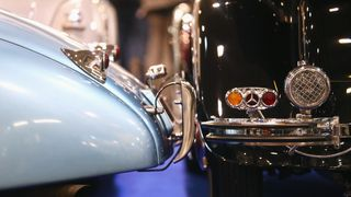 A detailed view of the Mercedes MB 500K Cabriolet B 1935 and Jaguar XK120 Fixed-Head Coupe 1951