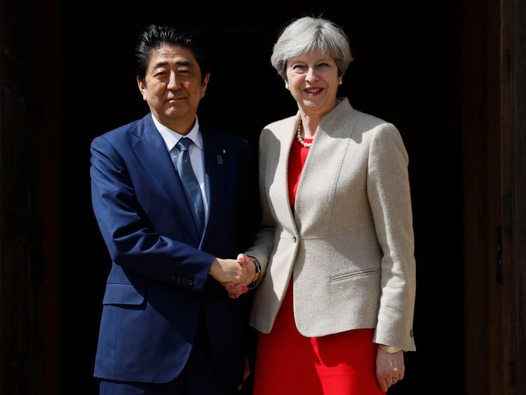 Theresa May welcomes Japan's Prime Minister Shinzo Abe ahead of talks at Chequers