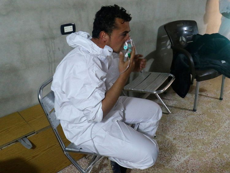 A man breathes through an oxygen mask after the attack