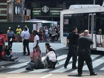 Injured person helped by passers-by