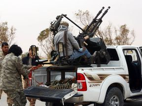 Members of forces loyal to Libya's Islamist-backed parliament General National Congress (GNC) prepare to launch attacks against Islamic State