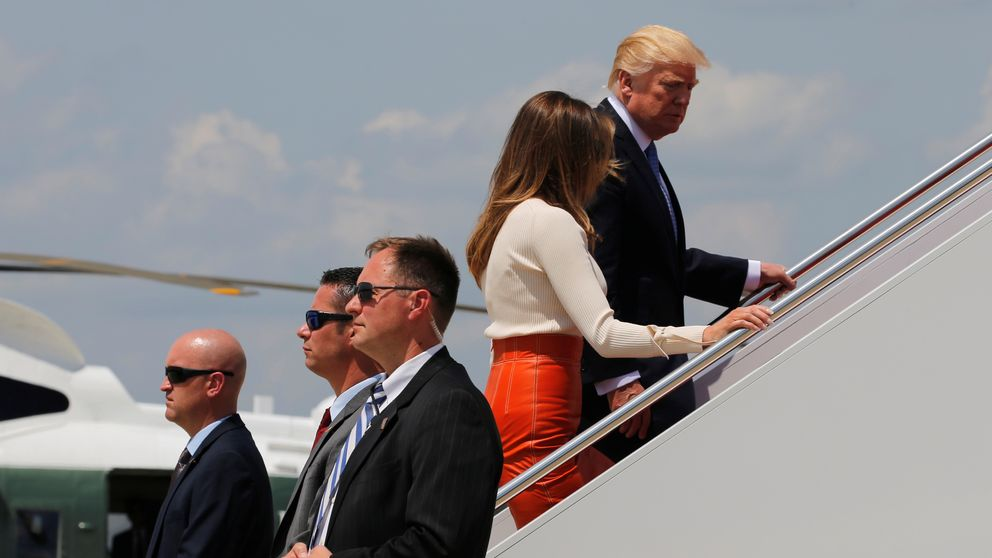 President Trump boards Air Force One with First Lady Melania Trump