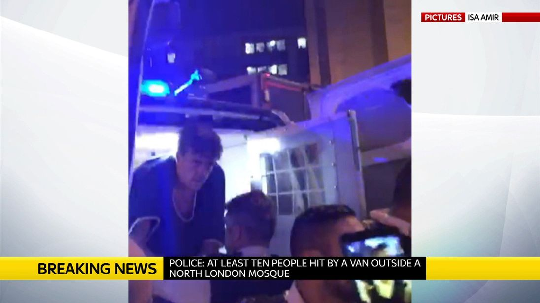 A man is arrested and put in the back of a police van after the collision in north London. Pic: Isa Amir