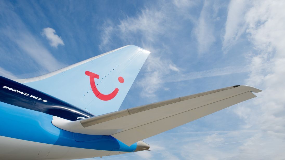 The tail of a plane with the TUI logo