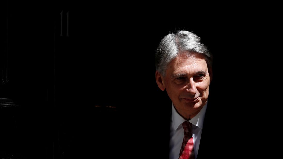 Philip Hammond, Britain's Chancellor of the Exchequer, waits to greet Party Secretary of China, Hu Chunhua, outside 11 Downing Street, in central London, Britain June 14, 2017.