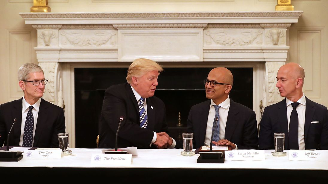 Trump (2nd L) welcomes (L-R) Apple CEO Tim Cook, Microsoft CEO Satya Nadella and Amazon CEO Jeff Bezos
