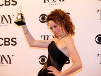 "Rebecca Taichman poses with her award for Best Direction of a Play for ""Indecent."""