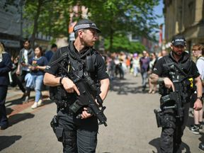 An armed police patrol in Manchester