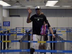 Dennis Rodman at Beijing's international airport en route to North Korea