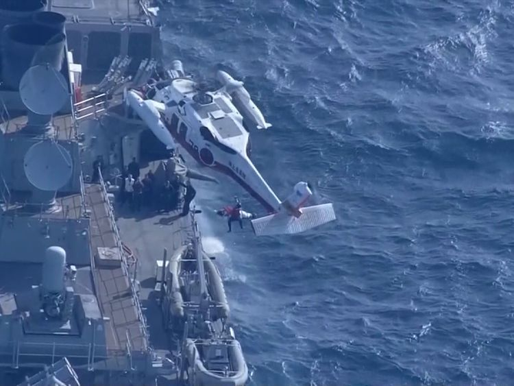 A sailor is rescued from the USS Fitzgerald after it collided with a container ship near Japan