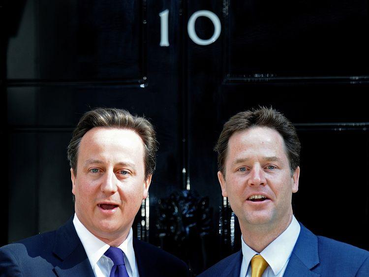 David Cameron and Nick Clegg pose outside No 10 on 12 May 2010