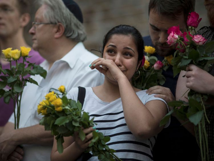 A woman cries during a vigil near the Finsbury Park Mosque