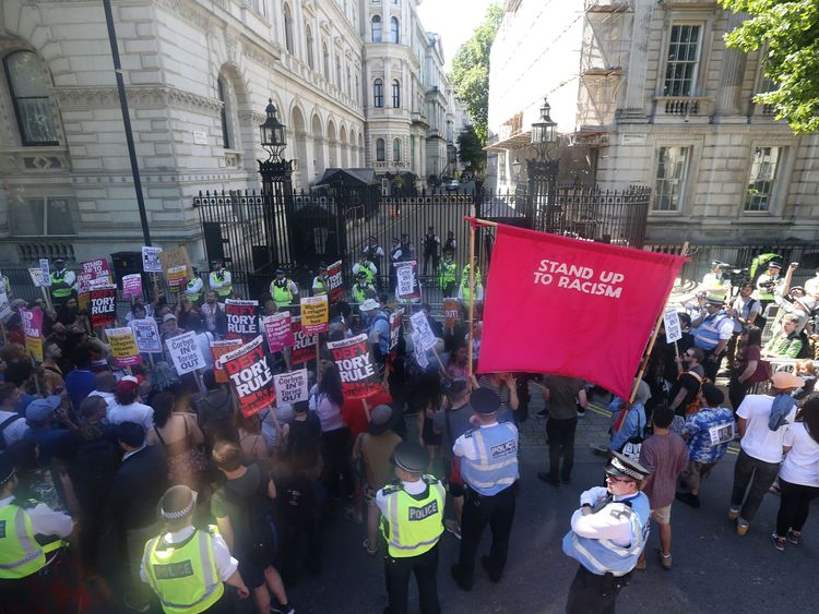 Protesters outside Downing Street to voice their anger at Theresa May's alliance with the DUP.