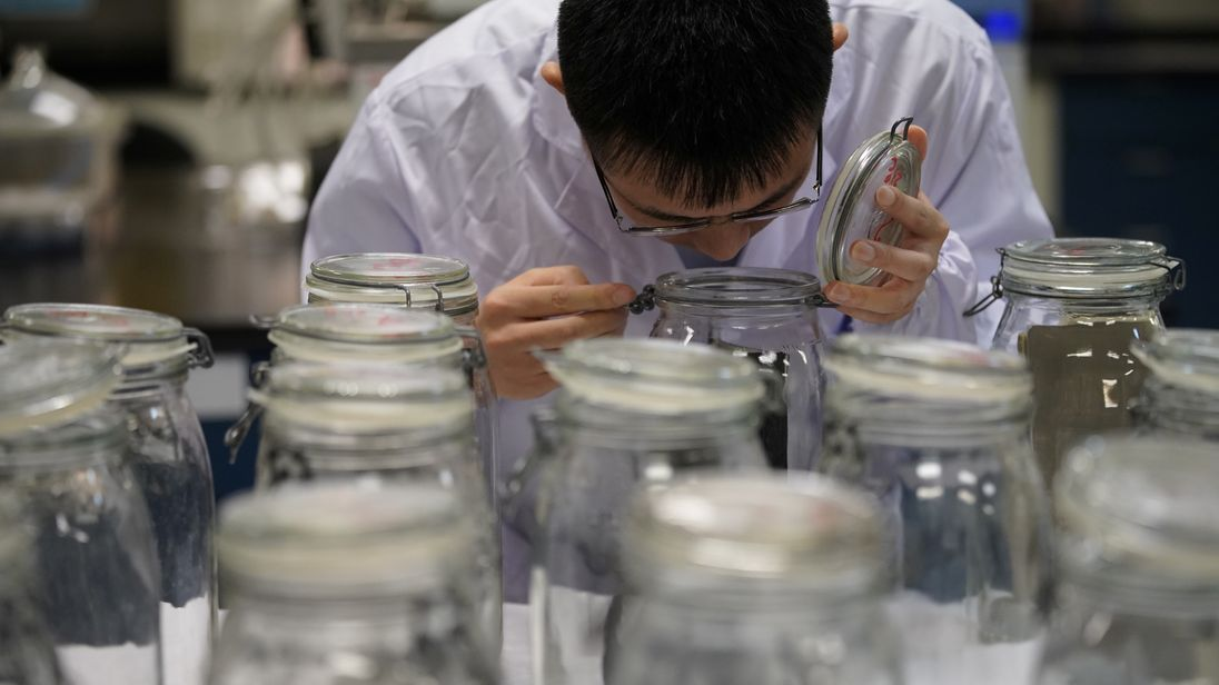 An employee conducts an odour test at the Polymer Laboratory at Ford's research and development centre in Nanjing
