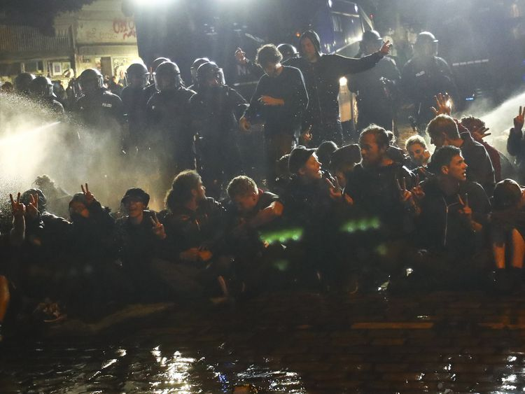 Riot police uses tear gas against people in the Schanze district following the G20 summit in Hamburg, July 9, 2017