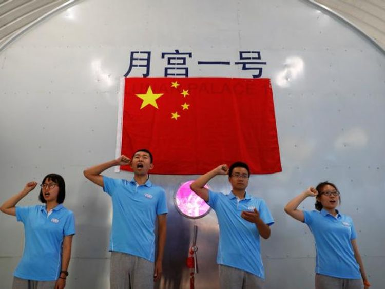 Volunteers take an oath before entering a simulated space cabin in which they will temporarily live. Pic: REUTERS/Damir Sagolj