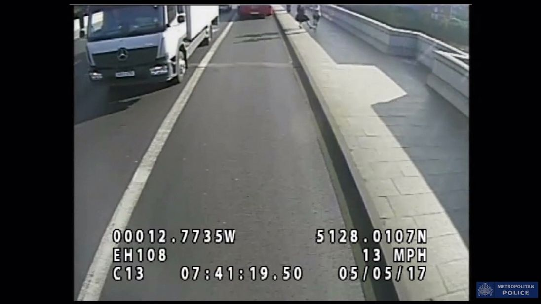The jogger was filmed apparently pushing the woman into the road