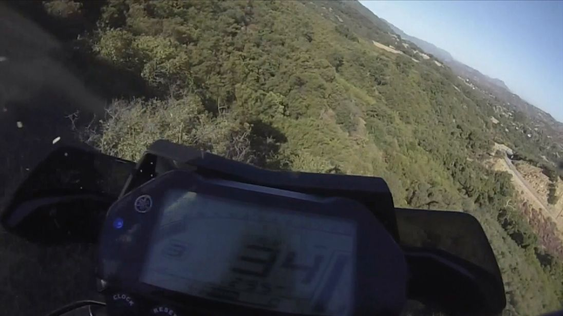 Man plunges 250ft over California cliff on motorcycle and survives