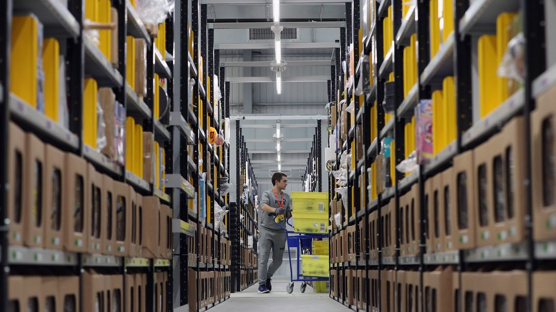 Parcels are processed and prepared for dispatch at Amazon's fulfillment centre on November 15, 2016 in Peterborough, England